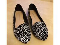 Black & white DP shoes size 7