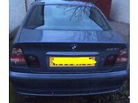BMW 323i SE (silvery blue)