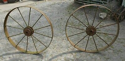 PAIR OF LARGE ANTIQUE RUSTIC IRON WHEELS