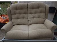 A TWO SEATER SETTEE FULLY UPHOLSTERED IN A SOFT GREEN PATTERN,4' WIDE APPROX. ONLY 18 MONTHS OLD