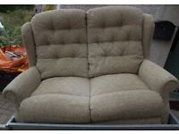 2 SEATER COTTAGE STYLE SETTEE ONLY 18 MONTHS OLD IN A GENTLE GREEN PATTERN