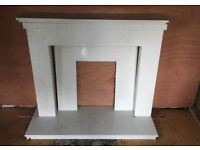 White granite fireplace with hearth