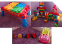 Massive collection of mega bloks including table, cars and people, compatible with lego and duplo