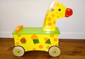 Beautiful wooden ride on giraffe and shape sorter