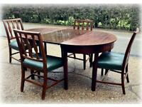 Antique mahogany extending dining table and 6 chairs