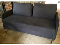 MADE, immaculate two seat sofa bed in grey fabric with silver legs