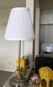 Two White and grey lamps in different sizes