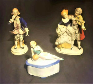 TWO FIGURINES OCCUPIED JAPAN