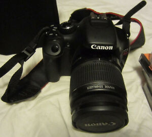 Mint Canon 550D DSLR with 3 batteries and many extras!!!