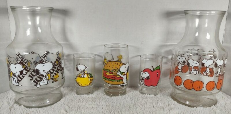 2 1965 snoopy Juice Pitchers. 1 apple, 1 lemon, & 1 hamburger/hotdog glasses.