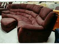 Large curved corner sofa with pouffee in vgc can deliver 07808222995