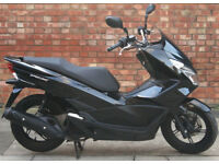 Honda PCX 125cc (65 REG) in black, Excellent condition, Only 2074 miles!