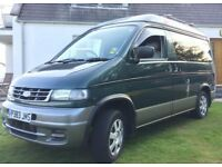 Ford Freda (Mazda Bongo) campervan with electric pop-up roof.