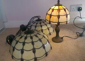 Two Tiffany style glass ceiling lights and matching table lamp