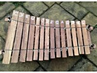 Pentatonic balafon from Ghana with 14 keys and a pair of beaters
