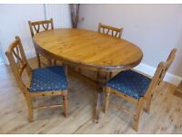 Ducal 'Victoria' solid pine oval extending dining table and four chairs