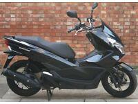 Honda PCX 125cc (65 REG), Excellent condition, Only 2074 miles!