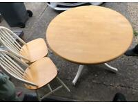 Solid oak extendable dining table & four chairs