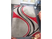 Red, brown and black swirly patterned rug