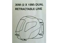 Dual retractable clothes line.