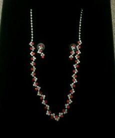 Red & Silver costume jewellery Earing & knecklace.