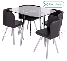 Brand new glass dining table and 4 black chairs