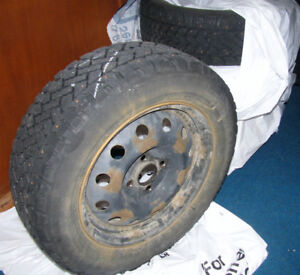 Set of 4 Winter Tires with Studs on Rims