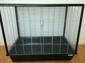 Large cage for housing rats/degu's or small animals. Comes with food bowl and water bottle.