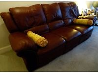 2 Burgundy Leather Sofas, 1 x 3 seater manual recliner & 1 x 2 seater electric recliner.