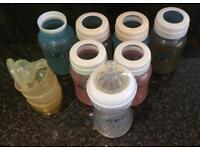Selection of Avent baby bottles and some accessories (unused teats, lids)