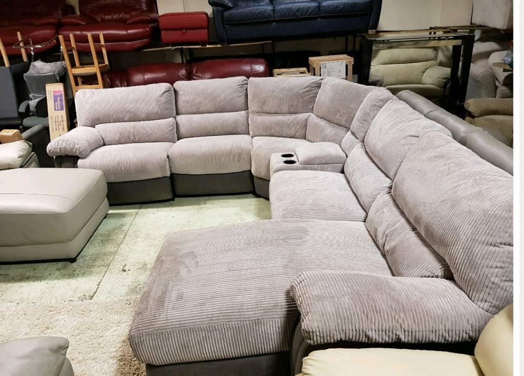 Grey jumbo cord corner sofa recliner