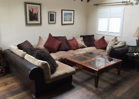 6 piece brown leather and beige colour material large sofa