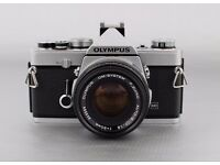 Olympus OM-1n with 50mm f1.8 and 28mm f3.5 lenses and lens hood
