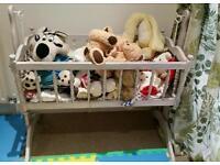 Swinging old fashioned baby crib