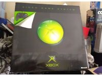xbox black console boxed with games