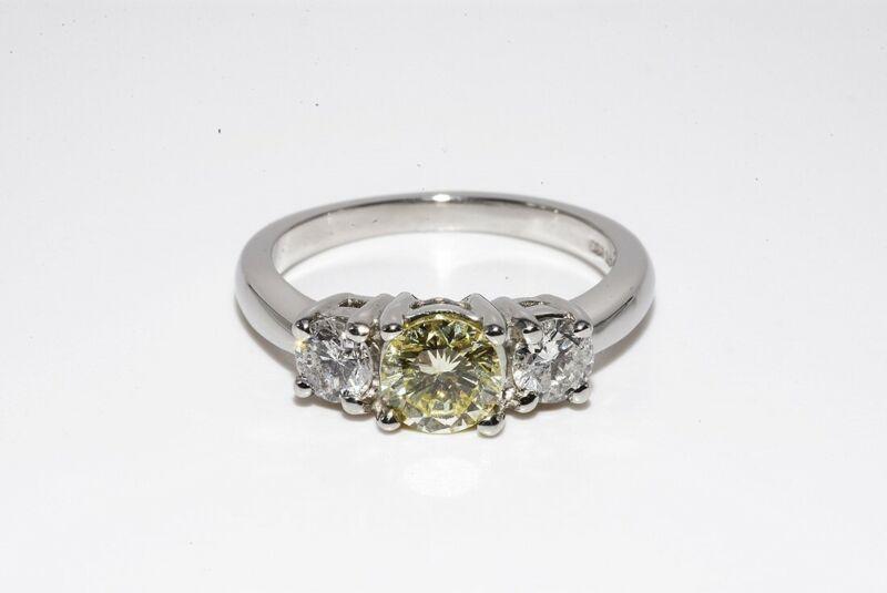 $4,500 .89CT NATURAL FANCY LIGHT YELLOW ROUND DIAMOND PLATINUM ENGAGEMENT RING