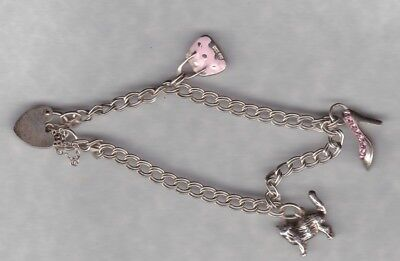 NICE SMALL SILVER CHARM BRACELET WITH THREE CHARMS IN A USED CONDITION