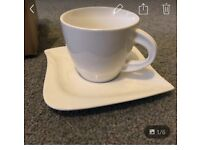 Brand new matching cups and saucers set