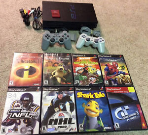 Playstation 2, 2 controllers, memory card and 8 Games!