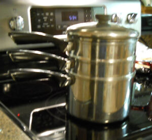 3 Stainless Steel Coronet 3-ply saucepans, stacked