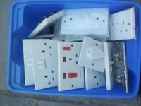 box of sockets, switches, boxes, jnc boxes, light pennants, spurs, blank plates. some chrome plated