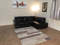 Ex-display Primo black leather corner sofa