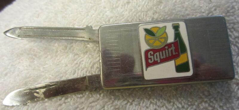 Vintage Squirt Soda ad money clip,knife,fingernail file,Rare,lemon lime logo