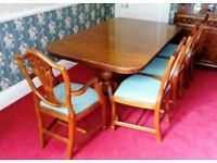 Table and 8 chairs. Antique reproduction double pedestal Yew veneered table with 8 matching chairs.