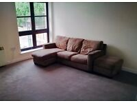 Brown 3 seater L shaped sofa and foot stool