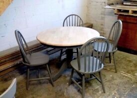 solid round dining table and chairs