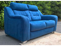 A New Designer Large 2 Seater Blue Natural Fabric Material Sofa.