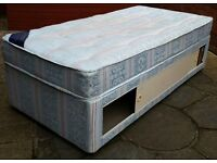 single divan bed, with sliding side panels for storage space inside. In used but good condition.