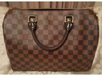 Louis Vuitton Speedy 25 Handbag