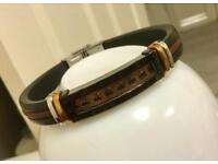 Men rose gold and silver bracelet with leather strap